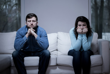 Couple after argument sitting on the sofa